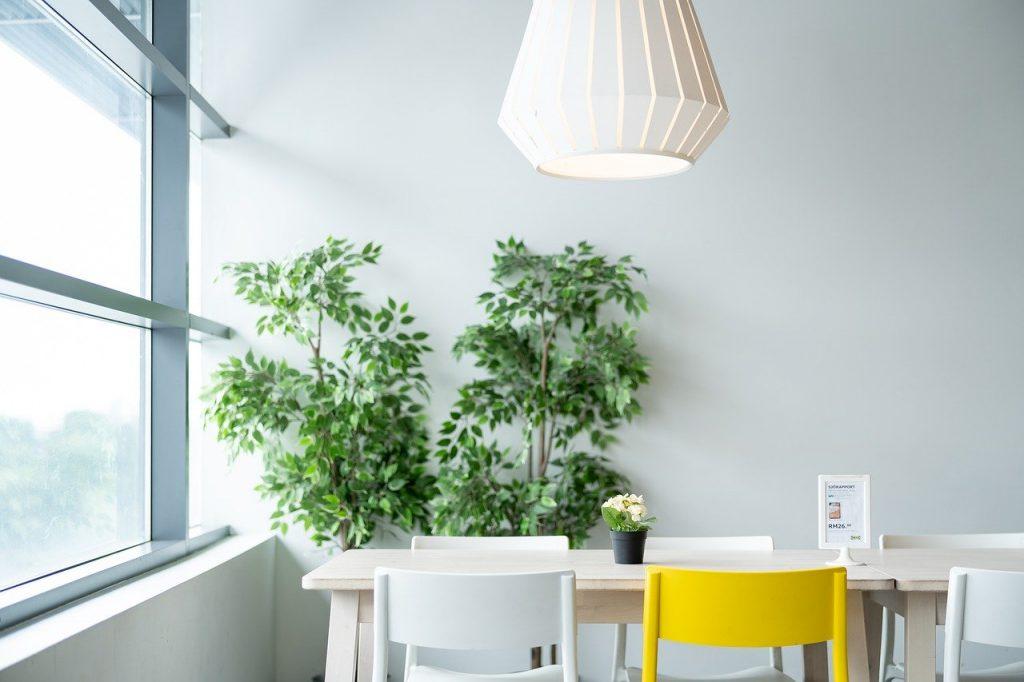 Monochrome accessories compliment leaf print wallpaper